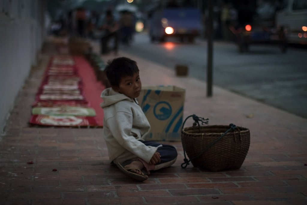 boy waiting for alms